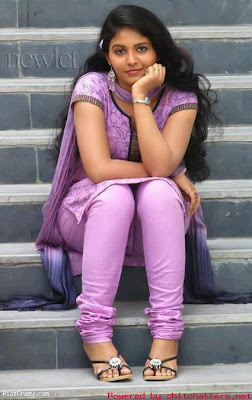 Cute Anjali with curly long hair style.
